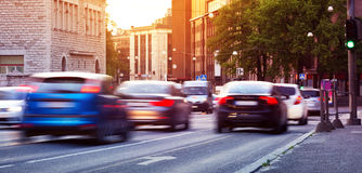 Cars moving on the urban road at dusk. In summer. Transport in the city Royalty Free Stock Images