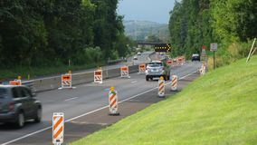 Cars Navigate a Closed Lane in a Road Construction Zone. 8939 Cars navigate a closed lane in a road construction repair zone stock footage