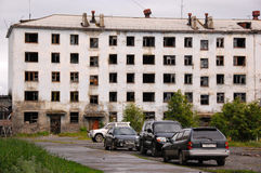 Cars near abandoned tower block house Royalty Free Stock Photography
