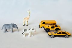 Cars near African animals. Danger on the road while traveling or safari stock photos
