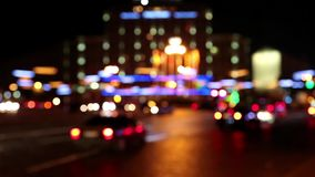 Cars in night city. Defocused and with stereo sound stock footage