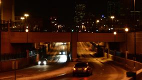 Cars at night fading out of focus stock footage