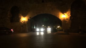 Cars at night in old town, Greece stock video