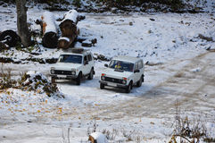 Cars Niva in the snowy terrain Royalty Free Stock Image