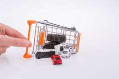 Cars out of a shopping cart Royalty Free Stock Image