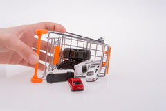 Cars out of a shopping cart Royalty Free Stock Images