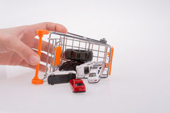 Cars out of a shopping cart Stock Images
