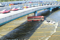 Cars park in row on a bridge to avoid flooding Stock Photo