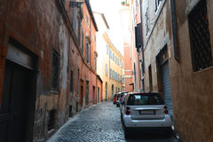 Cars parked along empty street Trastevere, Rome Royalty Free Stock Images