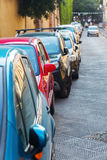 Cars parked along the road Royalty Free Stock Image