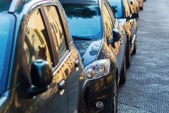 Cars parked along the road Stock Photography