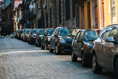 Cars parked along the streets of the town. Royalty Free Stock Photos