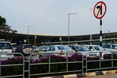 Cars are parked around an International Airport in India. Cars parked around the taxi zone of an international airport in Bangalore India isolated unique royalty free stock images