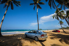 Cars Parked on Beach, Playa Grande, Cabrera, Dominican Republic. Silver and red sedan cars parked on Playa Grande in the Dominican Republic Stock Photos