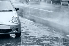 Cars parked in downpour Stock Images