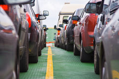 Cars parked on the ferry. Over the river Shannon at Tarbert in Ireland royalty free stock photography