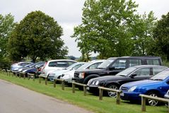 Cars parked in a field Royalty Free Stock Image