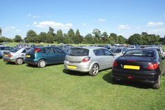 Cars parked in a field Stock Photos