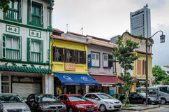 Cars parked in front of historic storefronts in modern Singapore Royalty Free Stock Photography