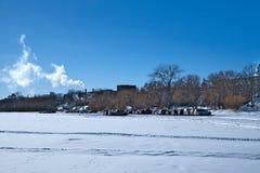 Cars parked on frozen Lake Bemidji near the University on a sunny day. Cars parked on frozen Lake Bemidji near the University where students have a shorter walk royalty free stock photo