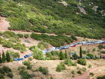 Cars parked on Mountain Dirt Road Royalty Free Stock Image