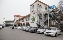 A row of car parked out of a restaurant. royalty free stock image