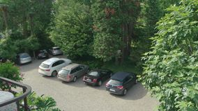Cars parked outdoor. Automobiles and nature summer. Car classes guide stock footage