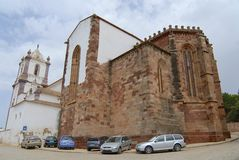 Cars parked outside of the Silves Cathedral in Silves, Portugal. Stock Photos