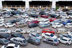 Cars parked at a park and side lot at a BTS station Stock Photography
