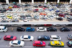 Cars parked at a park and side lot at a BTS station Stock Image