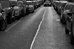 Cars parked on the roadside Royalty Free Stock Photo