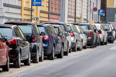 Cars parked on the roadside. Symbol for parking, mobility, fees royalty free stock photo