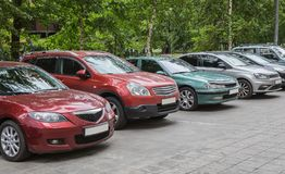 Cars parked in a row. Stock Image