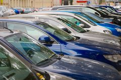 Cars parked in a row Stock Image