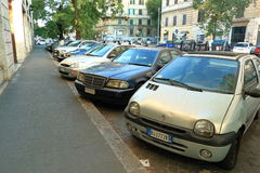 Cars parked in a row on the street of Rome, Italy Royalty Free Stock Images