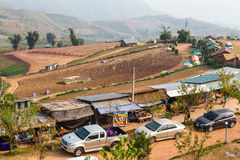 Cars parked shops. Cars parked on a dirt road near the shops, agricultural plateau in Thailand Stock Photography
