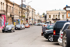 Cars parked on a street in Kutaisi city. KUTAISI, GEORGIA - MAY 27: Cars parked on a street in Kutaisi city center on May 27, 2016 in Kutaisi, Georgia Royalty Free Stock Image