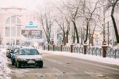 Cars parking in the avenue of Victory in Gomel. Snowy street in Royalty Free Stock Photo