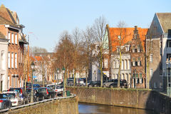 Cars parking on canal embankment  in the Dutch town Den Bosch. Royalty Free Stock Photography