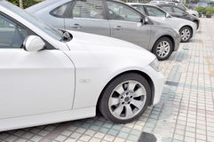 Cars Parking In Line Royalty Free Stock Photos