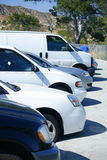 Cars In the Parking Lot. Mixed kinds of cars with their fronts lined up in the parking lot Royalty Free Stock Photo