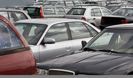 Cars on a parking lot. Cars parking in a row on a parking lot Stock Images