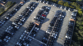 Cars in a parking lot. Aerial image of cars in a parking lot shot from above Stock Photo