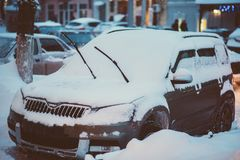 Cars are parked along the roads covered in snow Royalty Free Stock Photo