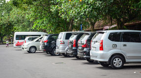 Cars at the parking lot in Bali, Indonesia Stock Photo