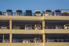 Cars in the parking lot. Import, sale of imported cars. Large selection of models. Parking in the open air. Blue sky, side sunlight Royalty Free Stock Photos