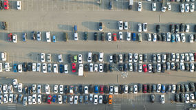 Cars in the parking lot near the shopping center. A lot of cars in the parking lot royalty free stock photos