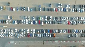 Cars in the parking lot near the shopping center stock footage