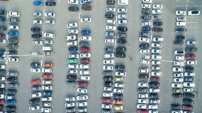 Cars in the parking lot near the shopping center. A lot of cars in the parking lot stock image