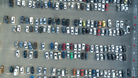 Cars in the parking lot near the shopping center. A lot of cars in the parking lot Stock Photos
